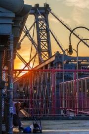 Sad man on the Williamsburg Bridge